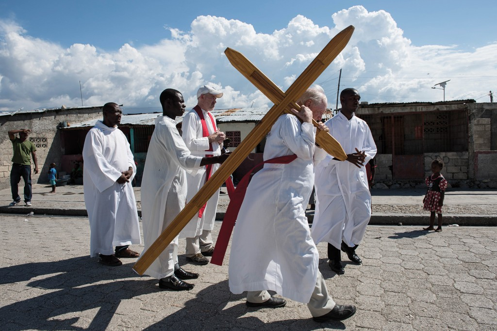 PORT-AU-PRINCE, HAITI - APRIL 3: Father Tom Hagan leads the procession of the Way of the Cross ceremony as it winds through the Cite Soleil neighborhood on April 3, 2015 in Port-au-Prince, Haiti. The Way of the Cross Procession is a Good Friday tradition for many Catholics world wide. (Photo by Andrew Renneisen/Getty Images)
