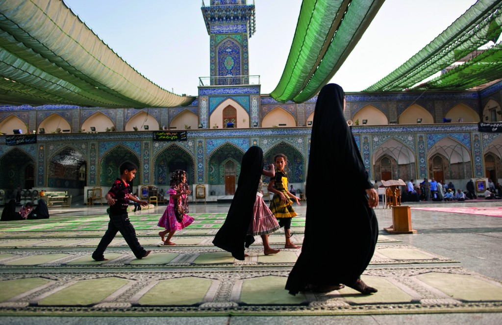 "From the series ""Baghdad, After the Storm."" Pilgrims visit Al Kazimayiah Shrine, a Shiite holy site relatively unharmed by the years of violence. © Lynsey Addario"