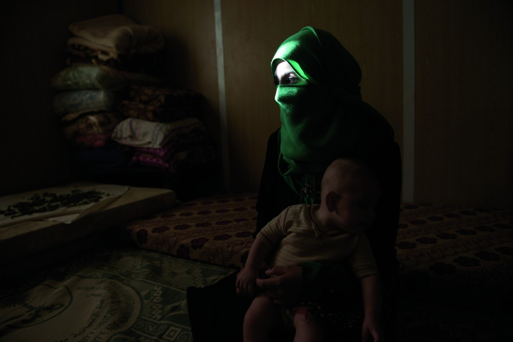 "From Addario's series ""Syrian Refugees' Young Brides."" Yasmeen, 16, sits with her baby in August 2014. Yasmeen returned home to live with her family at the Zatari refugee camp after leaving her abusive husband. © Lynsey Addario"