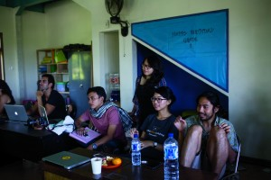 26 July 2015 - Ubud, Bali, Indonesia - Maggie Steber's class watches their final presentation edit at the 8th annual Foundry Photojournalism Workshops in Ubud, Bali, Indonesia.
