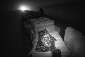Choum, Mauritania - 23 January, 2016:Being a long journey, about 16/18 hours of Nouadhibou to Zouarete, people end up resting inside the wagons. In this case upon Foam.The Iron Train is one of the longest train in the world, the train is about 2.5 km. A journey that goes from Nouadhibouh to Zouerate, totaling 652 km in the middle of the Sahara desert that lasts about 20 hours. An epic journey where residents, poor and penniless use dangerous train to visit relatives in the homeland or carrying goods such as live animals. High temperatures during the day and very low temperatures during the night makes the journey not easy. But the worst is the dust that is produced by wagons full of iron minerals that come from a mine from 30km of Zouarate to be unloaded in cargo boats in the port of Nouadhibouh.CREDIT: Daniel Rodrigues