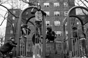 Juan Neira, Chavi Leon, Marco Vasquez, Edwin Amaro, Cole Jeffers and Jaylen Reid take an afternoon break and head outside to play around the playground in the Patterson projects, 17 Feb 2016, Mott Haven, South Bronx, New York.