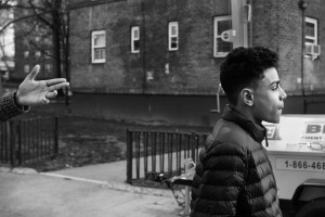 Chavier Leon walks past the Patterson Projects, 10 Apr 2016, southern Bronx, New York.