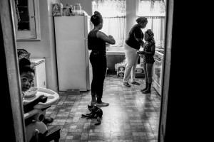 CAMDEN, NEW JERSEY -- AUGUST 10 Keisha Boone makes breakfast for the six kids she takes care of on August 10, 2013 in Camden, New Jersey. Keisha is one of many single mothers living in Camden. Her first husband was shot and killed, and the father of her most recent child is currently in jail.   (Andrew Renneisen/Getty Images Reportage)