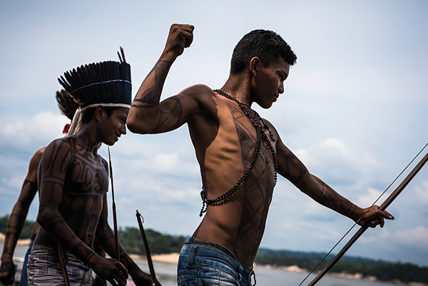 NOVEMBER 27, 2014. Munduruku indigenous youth fire arrows for fun during the Carnival of Resistance protest against plans to construct a series of hydroelectric dams on their river in in Para State, Brazil,