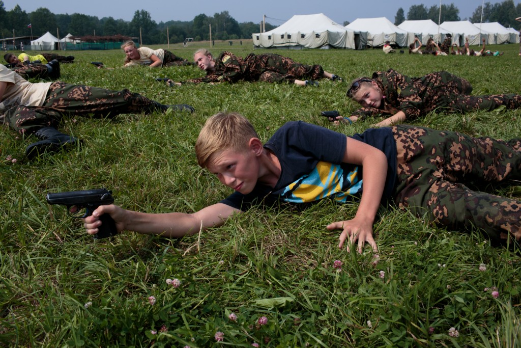 """Students train in firearms at Военно-Исторический Лагерь Бородино 2016, the Historical-War Camp, in Borodino, Russia. 24 July 2016. They are using air-soft guns for the practice and competition. Air-soft is a sport that replicates military action, but fire non-metallic pellets. The camp teaches information about the basic kinds of weapons, bases and firing rules, sniper rifles, and different type of weapons. Borodino is famous for a battle fought on 7 Sep 1812 - the deadliest day of the Napoleonic Wars. 350 adolescents are in attendance, ranging in ages from 11 to 17, and lasts throughout the summer. Students learn a variety of skills from tactical training in handguns, loading and unloading automatic guns, physical endurance, knife throwing, and others. The project statement of the camp says: """"To awaken in the younger generation a keen interest in the history of the Fatherland, the glorious deeds of our ancestors, to facilitate the expansion of military-historical knowledge."""""""
