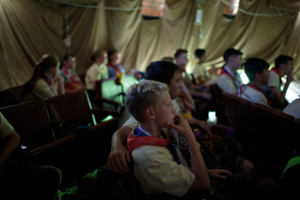 """Students escape the heat and watch war films at Военно-Исторический Лагерь Бородино 2016, the Historical-War Camp, in Borodino, Russia. 26 July 2016. Borodino is famous for a battle fought on 7 Sep 1812 - the deadliest day of the Napoleonic Wars. 350 adolescents are in attendance, ranging in ages from 11 to 17, and lasts throughout the summer. Students learn a variety of skills from tactical training in handguns, loading and unloading automatic guns, physical endurance, knife throwing, and others. The project statement of the camp says: """"To awaken in the younger generation a keen interest in the history of the Fatherland, the glorious deeds of our ancestors, to facilitate the expansion of military-historical knowledge."""""""