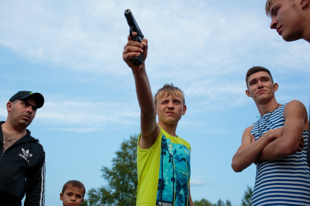 """Igor Fast (14) from Stavropol practices shooting before the start of """"Orthodox Warrior"""" camp. They are using air-soft guns for practice and competitions. """"Orthodox Warrior"""" camp takes place in Diveevo, the center of pilgrimage for Orthodox Christians in Russia, 31 July, 2016. The relics of one of the most revered saints, St. Seraphim, are celebrated on the 1 of August, attracting pilgrims from all across the country. The participants of the camp train not only in martial arts and tactical training, but unite under their Orthodox faith. Various competitions are held throughout the week, including Cossack dagger training and military tactical training. Attendees come from all across Russia, including regions like Stavropol."""